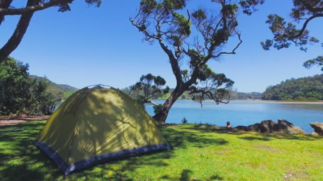 Camping at Mahurangi Regional Park, Auckland, New Zealand.