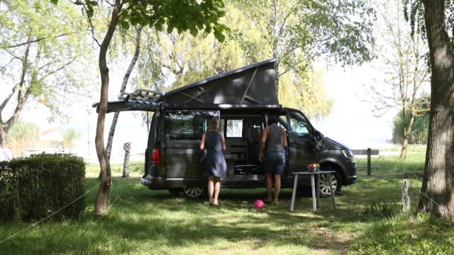 camping bus at lake balaton in hungary - tree trunk stock videos & royalty-free footage