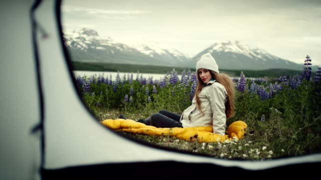 camping in the wild. woman admiring view from a tent - woolly hat stock videos & royalty-free footage