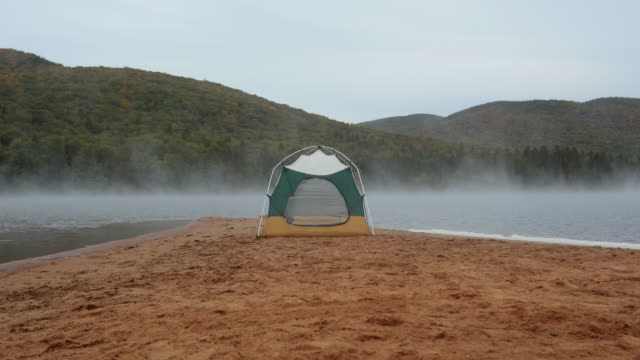 camping on the beach at sunrise - tent stock videos & royalty-free footage