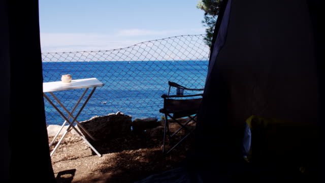 ws ds camping on the beach - picnic table stock videos and b-roll footage