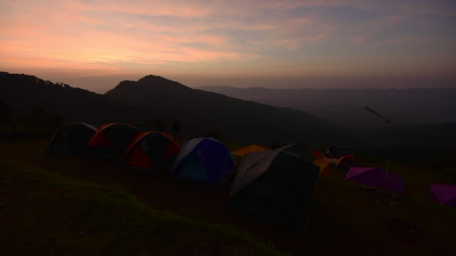 Camping tents in the sunset