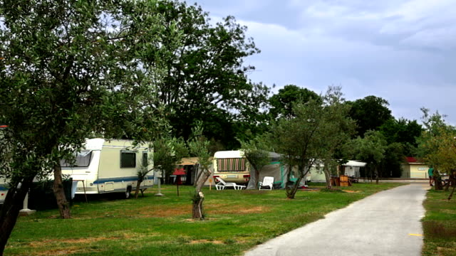 hd: camping with caravans and trailers - camper van stock videos & royalty-free footage