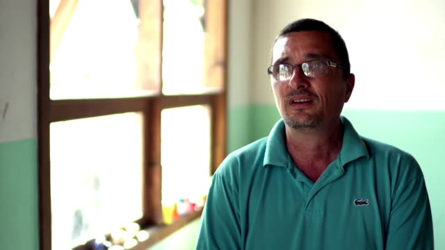stockvideo's en b-roll-footage met campo bahia & the ampare orphanage. the story of padre otto saffran and how he left drug abuse behind, became a pastor and now helps children at the... - padre