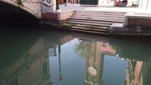 "campo santi apostoli"" in venice, italy, in a strangely desolate and silent venice, on april 19, 2020 in venice, italy. the italian government... - venedig stock-videos und b-roll-filmmaterial"