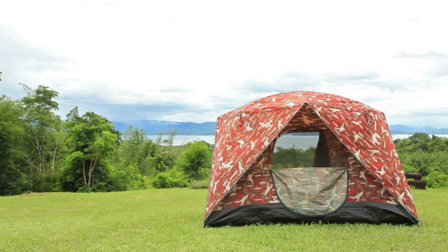 Campsite Tent at mountain and lake landscape