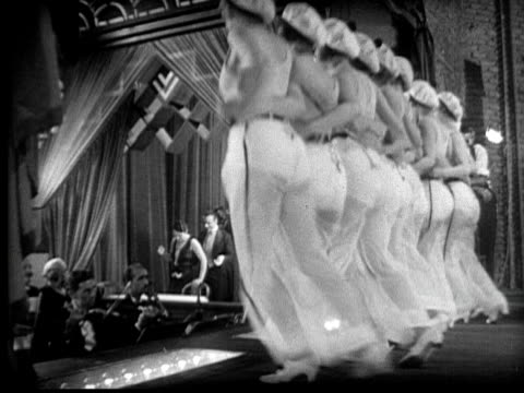 ms, la, b&w, can can dancers on stage, 1920's  - 1920 stock-videos und b-roll-filmmaterial