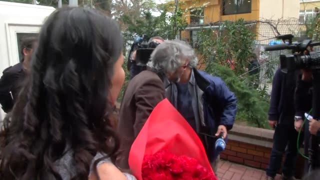 can dundar editor-in-chief of the newspaper cumhuriyet, and the daily's ankara bureau chief erdem gul arrive at headquarters of newspaper... - publication stock videos & royalty-free footage