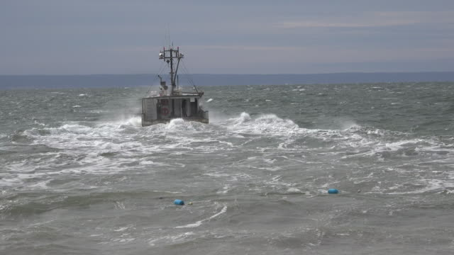 canada bay of fundy boat moves out across choppy waves - nautical vessel stock videos & royalty-free footage