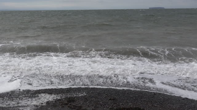Canada Bay of Fundy wave action on pebble beach pan