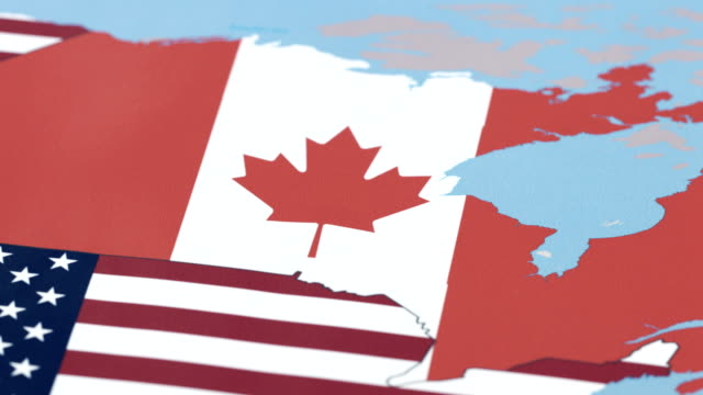 canada borders with national flag on world map - mid atlantic usa stock videos and b-roll footage