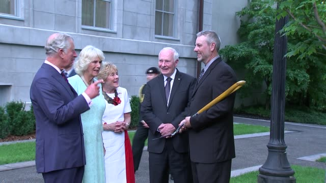prince charles and camilla visit prince charles and camilla along and welcomed / prince charles and camilla plant a sugar maple tree in the grounds... - camilla duchess of cornwall stock videos and b-roll footage