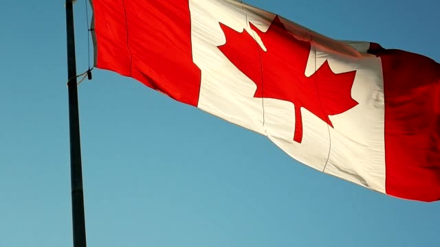 canada flag waving in the sky