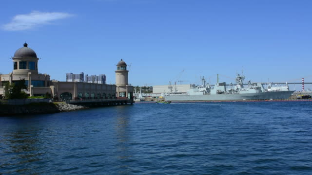 Canada Halifax  Nova Scotia harbour with boats and battleships with big bridge over water into city on McKay Bridge