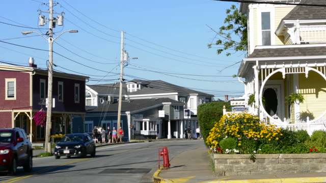 canada mahone bay nova scotia small village with shops and traffic on main street in relaxing tourist town - small town stock videos & royalty-free footage