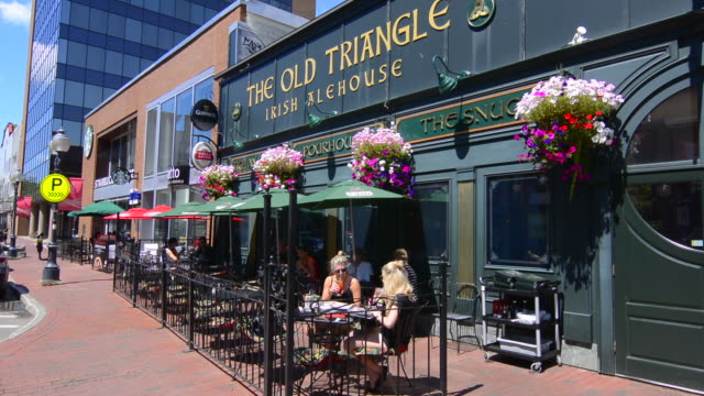 canada moncton new brunswick main street cafe called old triangle irish alehouse with locals drinking - pavement cafe stock videos & royalty-free footage