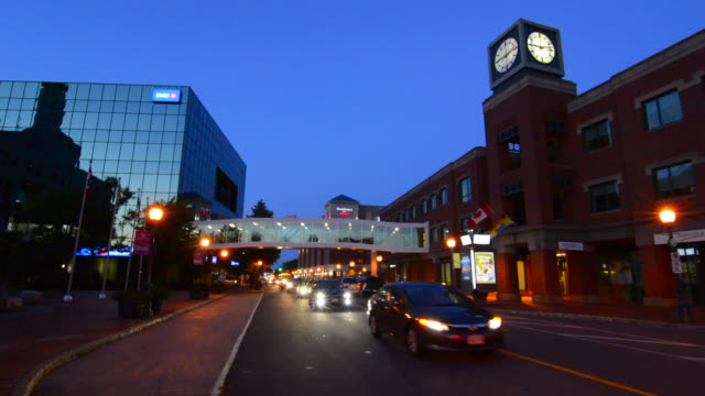 Canada Moncton New Brunswick night exposure of blurred traffic on Main Street and clock tower with bridge