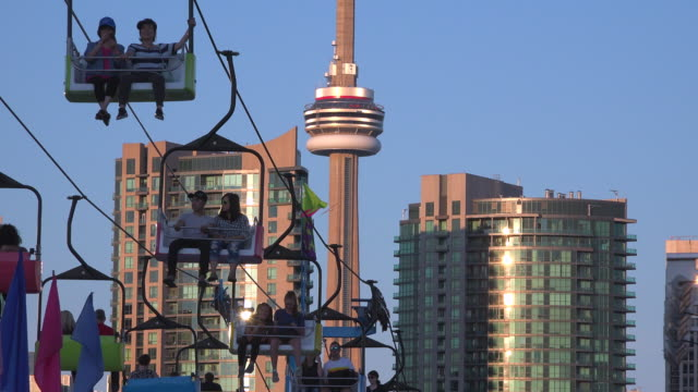 canada national exhibition or cne in toronto cable cars ride or gondola lift and the cn tower in the scene - overhead cable car stock videos and b-roll footage