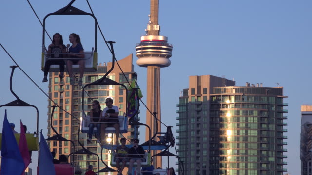 canada national exhibition or cne in toronto zoom out from the cn tower with cable car rides or gondola lift in the scene - overhead cable car stock videos and b-roll footage
