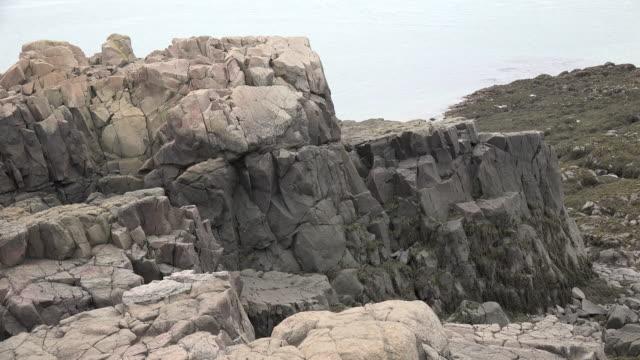 Canada Nova Scotia light colored rocks above Bay of Fundy