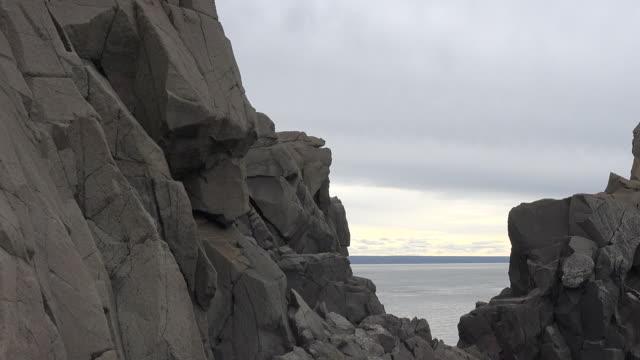 Canada Nova Scotia looking at Bay of Fundy between rocks pan