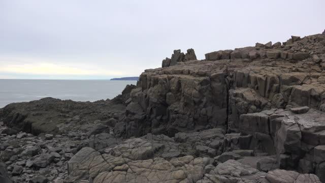 Canada Nova Scotia rocks and Bay of Fundy at high tide