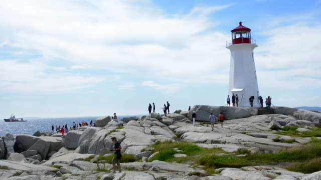 canada peggy's cove nova scotia peaceful lighthouse 1868on rocks with tourists walking on shore - nova scotia stock videos and b-roll footage