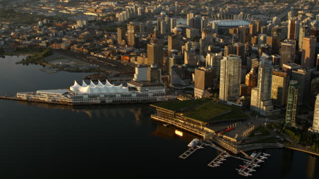 AERIAL Canada Place and Downtown Vancouver shining in rising sun