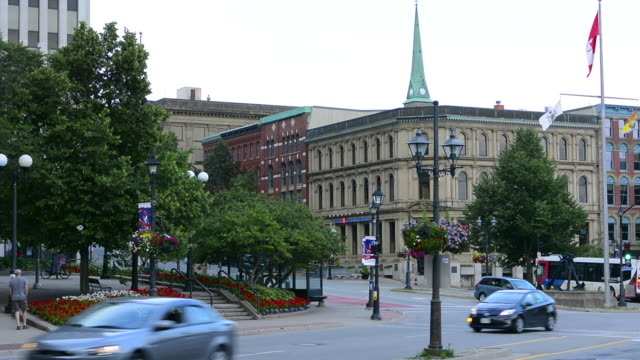 canada saint john new brunswick canadian flag and building above traffic at market street and water street uptown - canadian flag stock videos & royalty-free footage