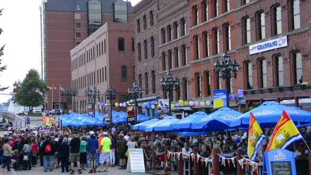 Canada Saint John New Brunswick Market Square Broadway crowd with party and music outdoors