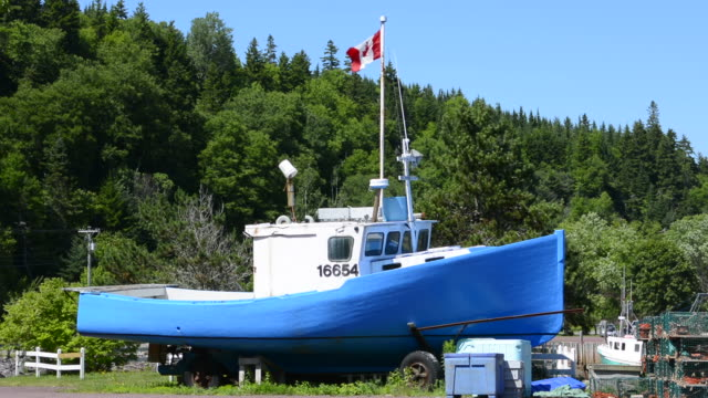Canada St Martins New Brunswick close up of lobster fishing boat with Canadian flag flying