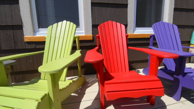 canada st martins new brunswick colorful home in town called the cronk house 1869 with colorful adirondack chairs on porch - traditionally canadian stock videos & royalty-free footage