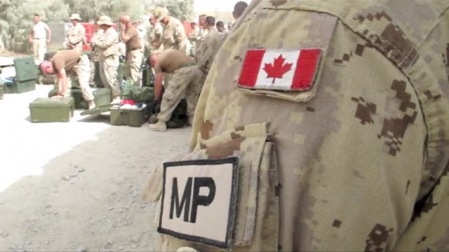 canada's top general in afghanistan held his head high as his combat troops flew out of the country on monday even if the long war against the... - kandahar afghanistan stock videos & royalty-free footage