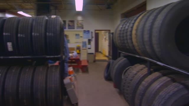 canadatire warehouse interior - pneumatico video stock e b–roll
