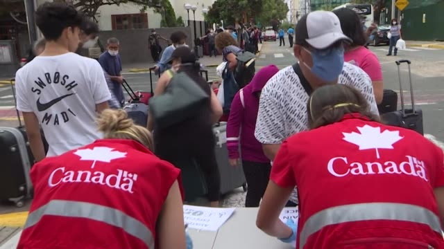 canadian citizens stranded in peru gather at the canadian embassy in lima to board buses headed to the military airport in order to head back home - head back stock videos & royalty-free footage