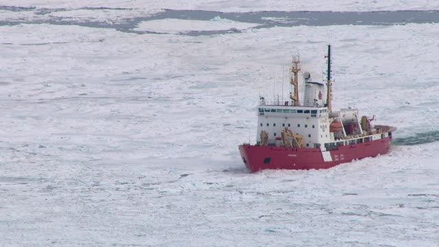 A Canadian Coast Guard icebreaker breaks through ice in Sydney Harbour, Nova Scotia, Canada.