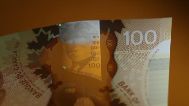 Canadian currency and USD in Toronto Ontario Canada on Friday July 27 2018