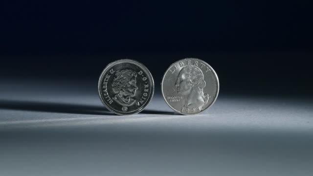 canadian currency and usd in toronto ontario canada on friday july 27 2018 - amerikanska mynt bildbanksvideor och videomaterial från bakom kulisserna