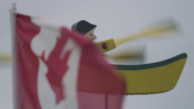 """canadian flag and whirligig in wind, nova scotia, canada - """"bbc natural history"""" stock videos & royalty-free footage"""