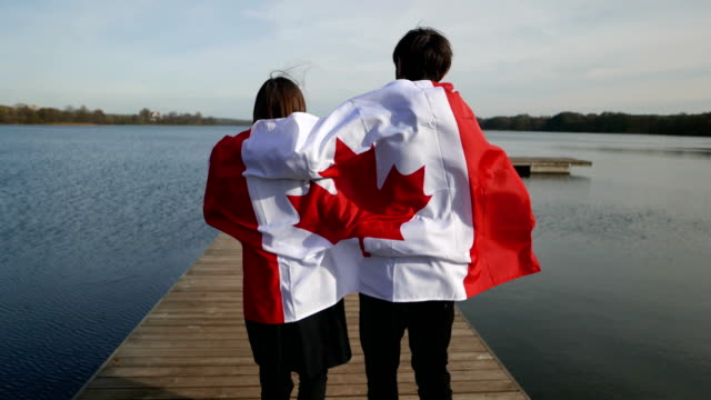 canadian flag in the open air and family emotions - bandiera del canada video stock e b–roll