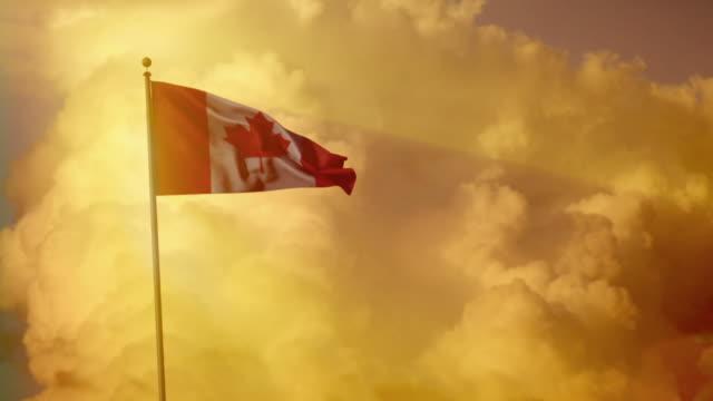 CGI WS Canadian flag waving against a dramatic golden sky