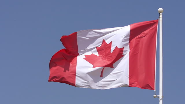 cu slo mo canadian flag waving in wind / caen, normandy, france - bandiera del canada video stock e b–roll