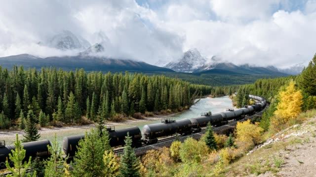 canadian freight train passing through on morant's curve in banff national park - rail transportation stock videos & royalty-free footage