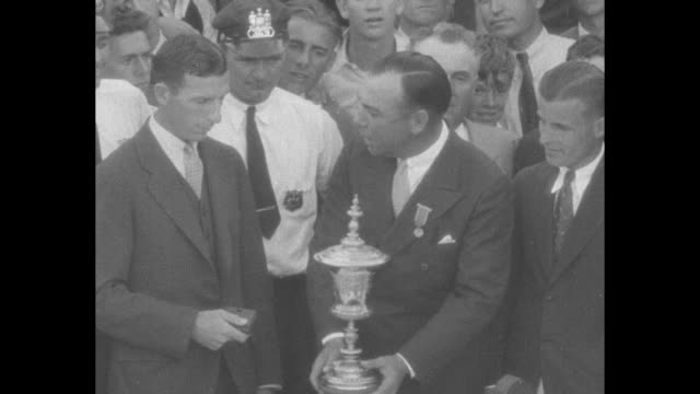 "canadian golfer c. ross ""sandy"" somerville receives trophy from h. h. ramsay, president of the us golf association, after winning the us amateur... - amateur stock videos & royalty-free footage"