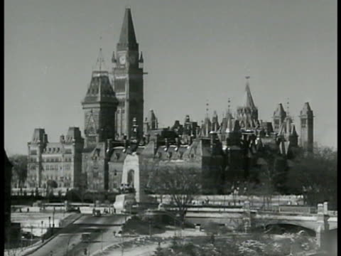 canadian house of parliament officer w/ baton leading canadian soldiers in coats gear rifles marching two officers walking toward house 'hostel... - ottawa stock-videos und b-roll-filmmaterial
