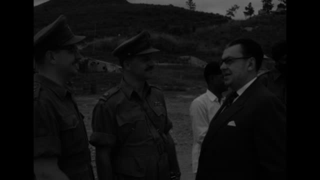 canadian minister of national health and welfare paul martin, sr., shakes hands with members of international military coalition as they stand... - laos stock videos & royalty-free footage
