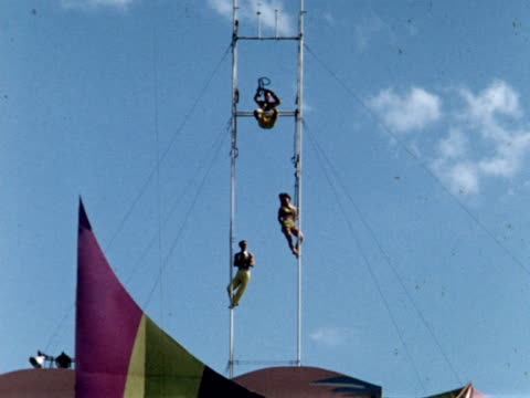 stockvideo's en b-roll-footage met 1955 montage canadian national exhibition, acrobats on tall poles / toronto, canada - 1955