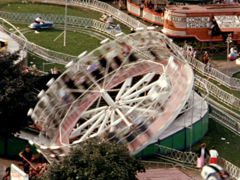 stockvideo's en b-roll-footage met 1955 montage canadian national exhibition, fairgrounds, spinning wheel / toronto, canada - 1955