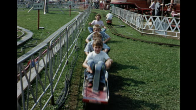 stockvideo's en b-roll-footage met 1955 montage canadian national exhibition, kids on roller coaster, rides, pony ride / toronto, canada - 1955