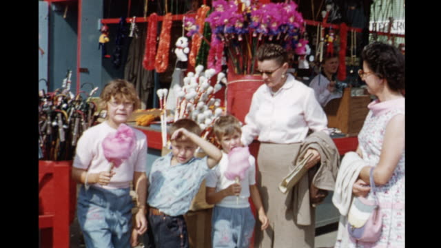 stockvideo's en b-roll-footage met 1955 montage canadian national exhibition, midway rides, kids waving, eating cotton candy / toronto, canada - 1955